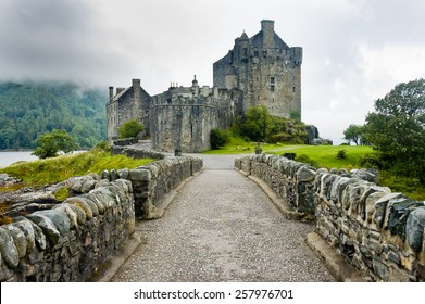 View of Eilean Donan Castle, Scotland in cloudy day with dramatic light