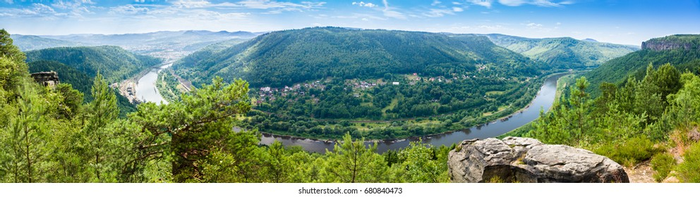 View of the Elbe valley in sunlight. Location place Bohemian Switzerland national park south-east of Dresden, Czech republic, Europe. Popular tourist attraction.