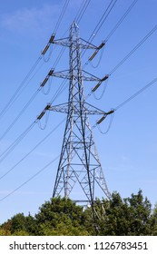 A view of an Electricity Pylon in the UK.  A pylon is a tall structure, used to support an overhead power line.