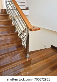 View of elegant glossy wooden stairs in the new house