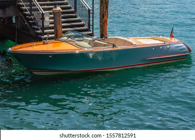 View of an elegant old fashioned wooden motor boat. A classic mahogany motorboat typical of Lake Como.