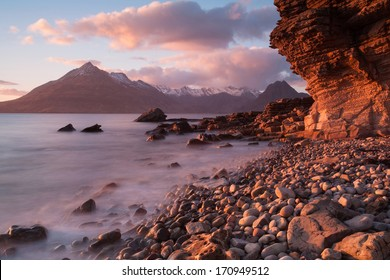 The view from Elgol beach at sunset looking towards the Cuillin mountains with the 'Honeycomb rock' in the foreground