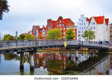 View of the embankment of Ilmenau river with old historical houses in traditional German architecture style. Luneburg city.