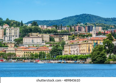 View of embankment of Lugano Lake and mountains. Lake Lugano (Lago di Lugano) is nestled between Lake Maggiore and Lake Como and lies partly in Switzerland and partly in Italy. Lugano, Switzerland.