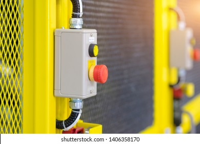 View of emergency switch on safety fence of automation machine