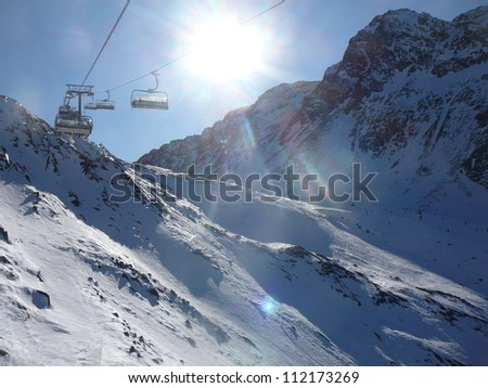 empty chair lift view to empty chair lift and snowcovered alps view empty chair lift snowcovered stock photo edit now