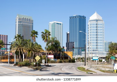 The view of an empty crossroad with Tampa downtown skyline in a background (Florida).