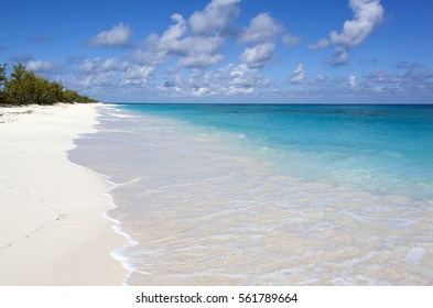 The view of an empty endless beach on uninhabited Half Moon Cay island (Bahamas).