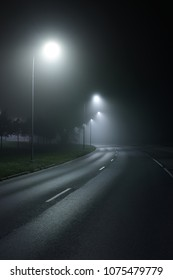 A view of the empty highway with lights at night