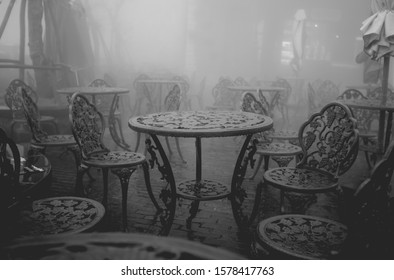 View of empty outdoor available metal chair and metal table in restaurant, Winter is foggy.