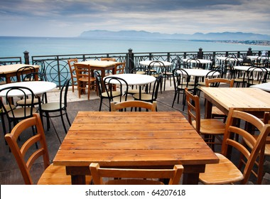 View of empty outdoor cafe in Sicily,Italy,focus on the table