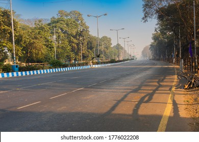 View of empty Red Road in the morning with blue sky above. Image shot at Kolkata, West Bengal, India.