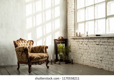 View of empty room with luxury arm chair near big panoramic window at white brick wall background. Stylish loft interior of studio.