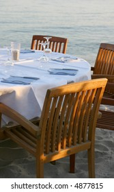 View of an empty table of a beach restaurant