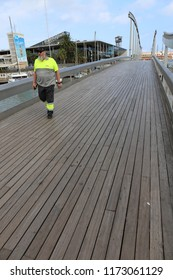 View of the end of La Rambla walking street, called 'La Rambla del Mar' which is a rotating bridge in Port Vell marina, Barcelona, Spain. August, 27, 2018. Scene of opening of the pedestrian walkway.