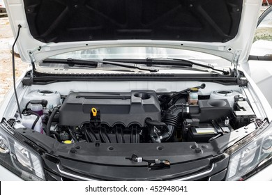 view of the engine and other details under the open hood of a car