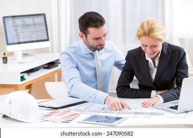 View of an Engineer and architect working at the office