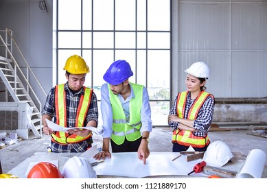 View of Engineer and Architects planning the scope of project and Industrial people working in the site office building.