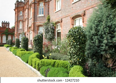 View of an English Manor with neat garden bordered with Box Hedging