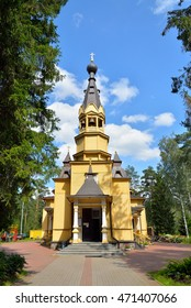 View of the entrance Bell tower of the Church of the Holy apostles Peter and Paul in the village of Vyritsa in the Leningrad region in summer Sunny day .