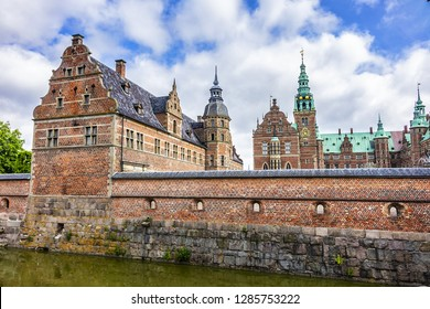 View from entrance of Frederiksborg Castle (Frederiksborg Slot, XVII century) - palace in Hillerod, Denmark. Frederiksborg Castle now History Museum.