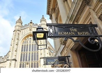 View of the Entrance of the Historic Roman Baths with Bath Abbey in the Background in the Historic Somerset City of Bath in England