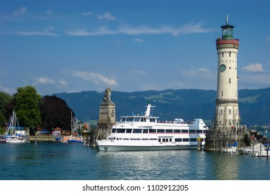 View of the entrance to the port of Lindau at Lake Constance with boat. Bavaria, Germany.