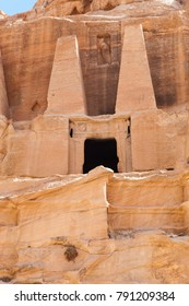 A view of an entrance will pillars to one of the ancient buildings carved into the stone in the Rose City of Petra, Jordan.