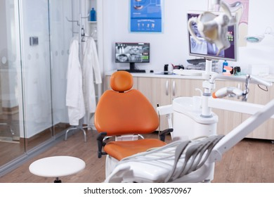 View at equipment in the modern dentist office. Stomatology equipment in dental private hospital with nobody in it. Different dental instruments and tools.