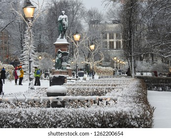 View to Esplanadi park during Christmas market. Statue of Johan Ludwig Runeberg statue  in middle of the avenue at 2018, Helsinki, Finland