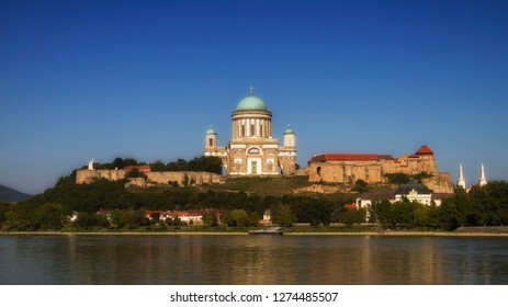 View of the Esztergom Basilica at the Castle Hill from the opposite bank of Danube, Hungary. Domed, neoclassical style place of worship.