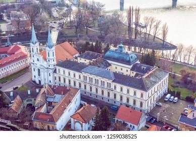 View from Esztergom basilica. Saint Ignatius church, Hungary. Travel destination. Cultural heritage. Urban scene. Religious architecture. Danube river. Purple photo filter.