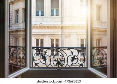 View of european building from an open window in Toulouse, France