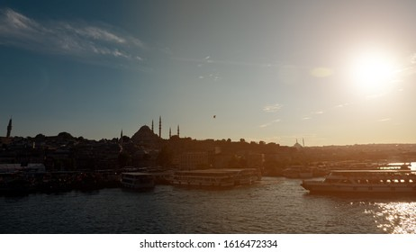 View of the evening Istanbul from the Galata bridge. Sulaymaniyah mosque.