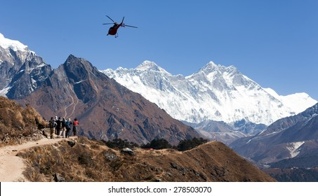 View of Everest and Lhotse with helicopter and tourists,  way to Everest base camp, Khumbu valley, Sagarmatha national park, Nepal
