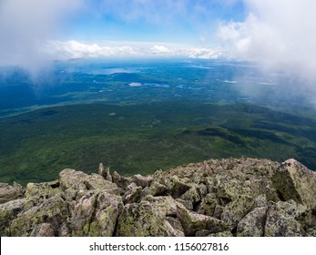 View of expansive lush valley from a mountain summit.  Katahdin, Baxter State Park, Maine.