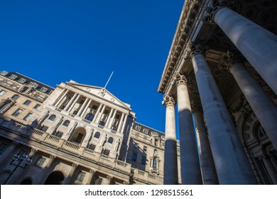 A view of the exterior of The Bank of England - the central bank of the UK, with the Royal Exchange building on the right-handside in London, UK.