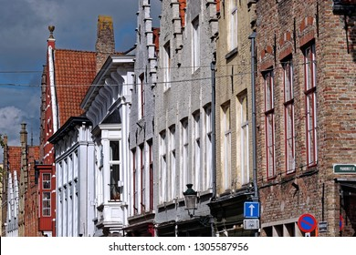 View from the exterior facade of a historic building downtown Bruges, Belgium.