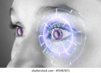 View of the Eye of a woman with digital interface in front of it