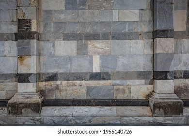 View of facade detail - wall of Primatial Metropolitan Cathedral of the Assumption of Mary in Piazza del Duomo in Pisa