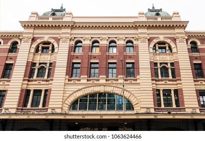 View of the facade of the Flinders Street Railway Station towards Flinders Street in Melbourne, Victoria, Australia
