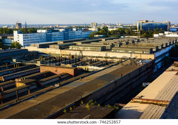 View of factory rooftops on sunny day