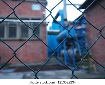 A view of the factory through the fence Zlin areal Svit