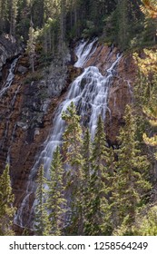 View of the falls off of the Grassi Lakes trail just outside of Canmore, beautiful natural waterfall in the forest in Canmore, in the Canadian Rockies in Alberta
