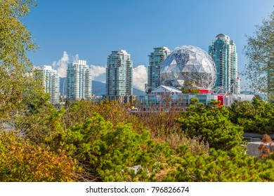View of False Creek and Vancouver skyline, including World of Science Dome, Vancouver, British Columbia, Canada, North America 16 September 2017