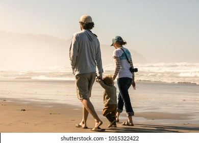 View of the family walking by the beach