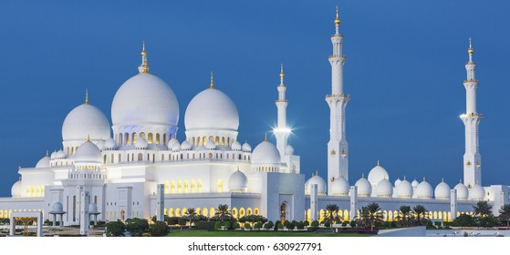 View of famous Abu Dhabi Sheikh Zayed Mosque by night, UAE.