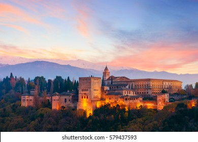 View of the famous Alhambra palacein Granada with Sierra Nevada mountains at the background, Spain