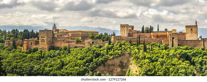 View of famous Alhambra at sunset - mediaeval Moorish palace and fortress complex. Alhambra originally constructed as a small fortress in AD 889. Granada, Andalusia, Spain.