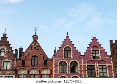 A view of the famous and colorful Flemish houses in the Market square (The Markt) of Bruges, West Flanders, Belgium, Europe.